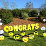 "Graduation Smiley display includes ""Congrats"" in 24"" letters with graduate's name on a star shaped sign, 12 graduation themed smiley faces, and customized signs with school name and ""Class of 2013"" in school colors.  Add balloons to show off school colors!!"
