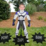 "5ft tall super hero customized with birthday boy's face.  Package includes ""Happy Birthday"" message sign, name of birthday boy, and 3 super hero starbursts."